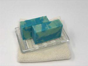 2 bars of aqua scent in glass dish